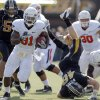 Oklahoma State\'s Jeremy Smith (31) runs up field as Missouri\'s Andrew Wilson (48) is up ended during a college football game between the Oklahoma State University Cowboys (OSU) and the University of Missouri Tigers (Mizzou) at Faurot Field in Columbia, Mo., Saturday, Oct. 22, 2011. Photo by Sarah Phipps, The Oklahoman