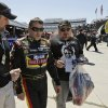 Tony Stewart, center, walks to his hauler after practice for Sunday\'s NASCAR Sprint Cup auto race at Martinsville Speedway in Martinsville, Va., Friday, April 5, 2013. (AP Photo/Steve Helber)