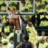 Baylor\'s Cory Jefferson (34) dunks over Kansas State\'s Shane Southwell (1) and Jordan Henriquez in the first half of an NCAA college basketball game on Saturday, March 2, 2013, in Waco, Texas. (AP Photo/Tony Gutierrez)
