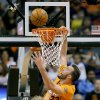 Photo - Phoenix Suns' Miles Plumlee (22) misses a dunk against the Detroit Pistons during the first half of an NBA basketball game, Friday, March 21, 2014, in Phoenix. (AP Photo/Matt York)