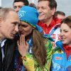 Photo - Russian President Vladimir Putin speaks with Olympic Village Mayor Elena Isinbaeva while visiting the Coastal Cluster Athletes Olympic Village ahead of the Sochi 2014 Winter Olympics on Wednesday, Feb. 5, 2014 in Sochi, Russia.  (AP Photo/Pascal Le Segretain, Pool)