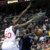 Charlotte Bobcats\' Michael Kidd-Gilchris (14) looks to shoot as Philadelphia 76ers\' Lavoy Allen (50) and Dorell Wright (4) defend in the first half of an NBA basketball game, Saturday, March 30, 2013, in Philadelphia. (AP Photo/H. Rumph Jr)