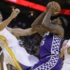 Photo - Sacramento Kings' DeMarcus Cousins (15) collides with Golden State Warriors' Andrew Bogut, left, during the first half of an NBA basketball game Wednesday, March 6, 2013, in Oakland, Calif. (AP Photo/Ben Margot)