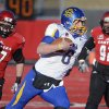 Photo - FILE - In this Dec. 7, 2013 file photo, South Dakota State quarterback Austin Sumner (6) runs the ball during an FCS college football game in Cheney, Wash. The poll of league coaches, media and sports information directors released Tuesday, July 29, 2014, has South Dakota State selected to finish second in the Missouri Valley Football Conference. Three-time defending national champion North Dakota State is picked to win the conference title.  (AP Photo/The Spokesman-Review, Colin Mulvany, File)  COEUR D'ALENE PRESS OUT