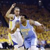 Denver Nuggets\' Andre Iguodala, right, dribbles past Golden State Warriors\' Stephen Curry during the first half of Game 6 in a first-round NBA basketball playoff series in Oakland, Calif., Thursday, May 2, 2013. (AP Photo/Ben Margot)