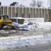 Snow is cleared from the driveway at the main fire station in Enid, Okla., Tuesday, Feb. 26, 2013. The city received an estimated 10 inches of snow and wind damage leaving 90 per cent of the town without power. (AP Photo/Enid News & Eagle, Billy Hefton) ORG XMIT: OKENI104