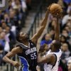 Orlando Magic\'s E\'Twaun Moore (55) blocks a shot attempt by Dallas Mavericks\' Mike James in the first half of an NBA basketball game Wednesday, Feb. 20, 2013, in Dallas. (AP Photo/Tony Gutierrez)