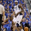 Oklahoma City\'s Kevin Durant (35) falls down after running into Brendan Haywood (33) of Dallas during game 1 of the Western Conference Finals in the NBA basketball playoffs between the Dallas Mavericks and the Oklahoma City Thunder at American Airlines Center in Dallas, Tuesday, May 17, 2011. Photo by Bryan Terry, The Oklahoman