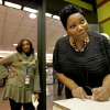 Benita Lewis, 41, of Atlanta, right, plays her family\'s birthdays in reverse as numbers on her Powerball lottery ticket as co-worker Perita Jones, 53, also, of Atlanta, looks on in the background at a convenience store, Wednesday, Nov. 28, 2012, in Atlanta.
