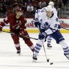 Photo - Toronto Maple Leafs left wing James van Riemsdyk (21) carries the puck past Phoenix Coyotes center Antoine Vermette (50) in the first period of an NHL hockey game, Monday, Jan. 20, 2014, in Glendale, Ariz. (AP Photo/Rick Scuteri)