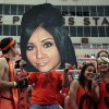 Nick Isburgh holds up a giant Snooki face before the college football game between Oklahoma State University (OSU) and the University of Texas (UT) at Boone Pickens Stadium in Stillwater, Okla., Saturday, Sept. 29, 2012. Photo by Sarah Phipps, The Oklahoman