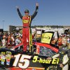 Photo -   Clint Bowyer celebrates on top of his car after winning the NASCAR Sprint Cup Series auto race, Sunday, June 24, 2012, in Sonoma, Calif. (AP Photo/Eric Risberg)