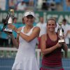 Photo - Caroline Wozniacki of Denmark, left, and Roberta Vinci of Italy hold their trophies after their tennis final match at the Istanbul Cup in Istanbul, Turkey, Sunday, July 20, 2014. Wozniacki overpowered second-seeded Vinci 6-1, 6-1 Sunday to win the Istanbul Cup final and clinch her first WTA title of the year.(AP Photo)