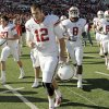 OU\'s Landry Jones (12) leaves the field in front of Matt Moreland (37), Brandon Caleb (8) and Ryan Broyles (85) after the college football game between the University of Oklahoma Sooners (OU) and the Texas Tech University Red Raiders (TTU) at Jones AT&T Stadium in Lubbock, Texas, Saturday, Nov. 21, 2009. Texas Tech won, 41-13. Photo by Nate Billings, The Oklahoman