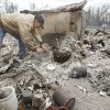 FIRES / WILDFIRES / HOUSE / DAMAGE/ AFTERMATH / RETURN: Kenneth Wertz dig through the remains of his house of more than 40 years as he looks for a few salvageable remains from the house that was destroyed by wildfires on Friday, April 10, 2009, in Choctaw, Okla. Photo by Chris Landsberger, The Oklahoman ORG XMIT: KOD