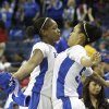 Kentucky\'s DeNesha Stallworth, left, celebrates with teammate Azia Bishop in the final seconds of their NCAA college basketball game against Georgia in the Southeastern Conference tournament on Saturday, March 9, 2013, in Duluth, Ga. Kentucky won 60-38. (AP Photo/John Bazemore)