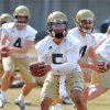Photo - Georgia Tech quarterbacks, from left,   Brady Swilling,  Justin Thomas, and freshman Matthew Jordan run through drills on the first day of spring football practice on Monday, March 24, 2014, in Atlanta.   (AP Photo/Atlanta Journal-Constitution, Curtis Compton)  MARIETTA DAILY OUT; GWINNETT DAILY POST OUT; LOCAL TV OUT; WXIA-TV OUT; WGCL-TV OUT
