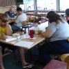 The Pen and Keyboard Writers meeting attendees work on an item to share. The group meets at Edmond\'s Golden Corral the third Saturday of each month from 10 AM to noon. New members are invited to the July 15 meeting. Community Photo By: Vivian Zabel Submitted By: Vivian,