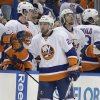 Photo - New York Islanders left wing Thomas Vanek (26), of Austria, celebrates with teammates after his goal against the Tampa Bay Lightning during the second period of an NHL hockey game, Thursday, Jan. 16, 2014, in Tampa, Fla. (AP Photo/Chris O'Meara)
