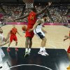 Deron Williams, second from right, of the United States makes a pass around Spain\'s Serge Ibaka (14) to teammate Kevin Love, left, during their men\'s gold medal basketball game at the 2012 Summer Olympics on Sunday, Aug. 12, 2012, in London. (AP Photo/Sergio Perez, Pool)