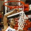 OSU Tiffany Bias (3) cuts down part of the net after the Women\'s NIT championship college basketball game between Oklahoma State University and James Madison at Gallagher-Iba Arena in Stillwater, Okla., Saturday, March 31, 2012. OSU won, 75-68. Photo by Nate Billings, The Oklahoman