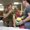 Wearing his British Army uniform, Britain\'s Prince Harry visits with wounded warriors undergoing physical therapy at the Military Advanced Training Center at Walter Reed National Military Medical Center in Bethesda, Md., just outside Washington, Friday, May 10, 2013. At right is Staff Sgt. Timothy Payne who lost his legs in an IED explosion in Afghanistan. (AP Photo/J. Scott Applewhite, Pool)