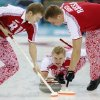 Photo - Russia's skip Alexey Stukalskiy, center, delivers the rock to sweepers Evgeny Arkhipov, left, and Petr Dron during men's curling competition against Great Britain at the 2014 Winter Olympics, Monday, Feb. 10, 2014, in Sochi, Russia. (AP Photo/Robert F. Bukaty)