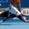 Serbia\'s Novak Djokovic reaches to play a forehand return to Radek Stepanek of the Czech Republic during their third round match at the Australian Open tennis championship in Melbourne, Australia, Friday, Jan. 18, 2013. (AP Photo/Dita Alangkara)