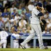 Photo - San Diego Padres starting pitcher Ian Kennedy, right, walks to the mound after Los Angeles Dodgers' Matt Kemp scores during the fifth inning of a baseball game in Los Angeles, Tuesday, Aug. 19, 2014. (AP Photo/Chris Carlson)