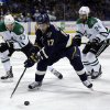 Photo - St. Louis Blues' Vladimir Sobotka, of the Czech Republic, reaches for the puck as Dallas Stars' Valeri Nichushkin, left, of Russia, and Jordie Benn, right, give chase during the second period of an NHL hockey game Saturday, March 29, 2014, in St. Louis. (AP Photo/Jeff Roberson)