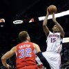 Atlanta Hawks\' Al Horford (15) goes up over Los Angeles Clippers\' Blake Griffin (32) in the first half of an NBA basketball game at Philips Arena in Atlanta, Saturday, Nov. 24, 2012. (AP Photo/David Tulis)
