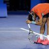 Photo - Rafael Nadal of Spain reacts as he plays  Stanislas Wawrinka of Switzerland during the men's singles final at the Australian Open tennis championship in Melbourne, Australia, Sunday, Jan. 26, 2014. (AP Photo/Aaron Favila)