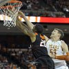 Texas center Clint Chapman (53) blocks a shot by Oklahoma State forward Michael Cobbins during the first half of an NCAA college basketball game Saturday, Jan. 7, 2012, in Austin, Texas. (AP Photo/Michael Thomas) ORG XMIT: TXMT106