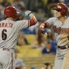 Photo - Arizona Diamondbacks third baseman Martin Prado (14) is greeted by Arizona Diamondbacks left fielder David Peralta (6) after hitting a solo home run in the ninth inning of a baseball game against the Los Angeles Dodgers on Saturday, June 14, 2014, in Los Angeles. T (AP Photo/Jayne Kamin-Oncea)