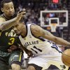 Photo - Utah Jazz's Trey Burke (3) defends against Memphis Grizzlies' Mike Conley (11) in the first half of an NBA basketball game in Memphis, Tenn., Monday, Dec. 23, 2013. (AP Photo/Danny Johnston)