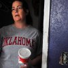 Summer Roberts shows the closet where she initially hid in the house before leaving before the tornado hit. Preparing for the worst, Roberts took a 2 liter of Diet Coke and Mountain Dew, a box of powdered doughnuts and a bag of funyuns into the closet. Photo by KT King, The Oklahoman