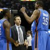 Oklahoma City coach Scott Brooks talks with Reggie Jackson (15) and Kevin Durant (35) during Game 3 in the second round of the NBA basketball playoffs between the Oklahoma City Thunder and Memphis Grizzles at the FedExForum in Memphis, Tenn., Saturday, May 11, 2013. Memphis won, 87-81. Photo by Nate Billings, The Oklahoman