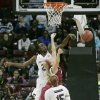 Photo - South Carolina's Aleighsa Welch, top, blocks the shot as Arkansas' Melissa Wolff, center, drives for the basket during an NCAA college basketball game on Sunday, Feb. 9, 2014, in Columbia, S.C. (AP Photo/Mary Ann Chastain)