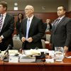 Defense attorneys Mark O\'Mara, left, Don West, center, stand with George Zimmerman during Zimmerman\'s trial in Seminole circuit court, in Sanford, Fla., Wednesday, July 3, 2013. Zimmerman is charged with second-degree murder in the 2012 fatal shooting of slain teen Trayvon Martin. (AP Photo/Orlando Sentinel, Jacob Langston, Pool)
