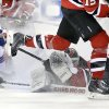 Photo - New Jersey Devils goalie Martin Brodeur falls in front of the goal as he blocks a shot during the first period of an NHL hockey game against the New York Rangers on Saturday, March 22, 2014, in Newark, N.J. (AP Photo/Mel Evans)