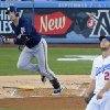Milwaukee Brewers\' Ryan Braun, left, watches a two-run home run off Los Angeles Dodgers starting pitcher Clayton Kershaw, right, during the fourth inning of a baseball game, Saturday, Aug. 16, 2014, in Los Angeles. (AP Photo/Mark J. Terrill)