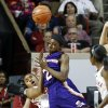 Northwestern State Lady Demons\' Tiandra Williams (2) runs over Oklahoma Sooners\' Jasmine Hartman (45) on her way to the basket as the University of Oklahoma (OU) Sooner women\'s basketball team plays the Northwestern State Lady Demons at the Lloyd Noble Center on Thursday, Nov. 29, 2012 in Norman, Okla. (AP PHOTO/The Oklahoman, Steve Sisney)