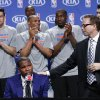Oklahoma City Thunder head coach Scott Brooks, right, puts his hand on the shoulder of a teary-eyed Kevin Durant during the news conference announcing Durant is the winner of the 2013-14 Kia NBA Basketball Most Value Player Award in Oklahoma City, Tuesday, May 6, 2014. (AP Photo/Sue Ogrocki)