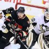 Photo - Pittsburg Penguins' Deryk Engelland (5) pushes Ottawa Senators' Colin Greening (14) in front of Penguins goaltender Tomas Vokoun (92) during the second period of their NHL hockey game in Ottawa, Ontario, Monday, April 22, 2013. (AP Photo/The Canadian Press, Fred Chartrand)