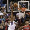 Photo - Sacramento Kings forward Rudy Gay, left, goes up for the stuff against Portland Trail Blazers forward Nicolas Batum, right, of France, during the first quarter of an NBA basketball game in Sacramento, Calif., Tuesday, Jan. 7, 2014. (AP Photo/Rich Pedroncelli)