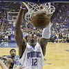 Photo - Orlando Magic's Dwight Howard (12) dunks against the Cleveland Cavaliers in the first quarter of Game 6 of the NBA Eastern Conference basketball finals Saturday, May 30, 2009, in Orlando, Fla. (AP Photo/John Raoux) ORG XMIT: DOA110