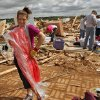 Miranda Lewis makes the best of a bad situation as she models a dress that was undamaged by Tuesday\'s tornado that destroyed her family\'s home west of El Reno, Wednesday, May 25, 2011. Photo by Chris Landsberger, The Oklahoman ORG XMIT: KOD