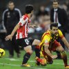 Photo - Barcelona's Francesc Fabregas, right, is tackled by Athletic Bilbao's Andoni Iraola during their Spanish League soccer match, at San Mames stadium in Bilbao, Spain, Sunday, Dec. 1, 2013. F.C. Barcelona lost the match 1-0. F.C. Barcelona lost the match 1-0.  (AP Photo/Alvaro Barrientos)