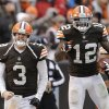 Photo - Cleveland Browns quarterback Brandon Weeden (3) celebrates with wide receiver Josh Gordon (12) after they connected on a 95-yard touchdown pass in the fourth quarter of an NFL football game against the Jacksonville Jaguars, Sunday, Dec. 1, 2013, in Cleveland. (AP Photo/Tony Dejak)