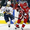 Carolina Hurricanes\' Drayson Bowman (21) works the puck in front of Buffalo Sabres\' Marcus Foligno (82) during the first period of an NHL hockey game, Tuesday, March 5, 2013, in Raleigh, N.C. (AP Photo/Karl B DeBlaker)